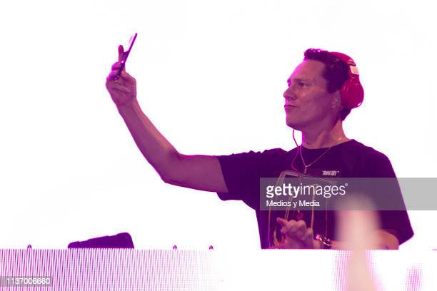 Tiesto takes a selfie as he performs in concert at the Melody Maker Hotel on March 19 2019 in Cancun Mexico