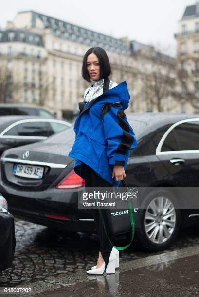 Tifany Hsu poses wearing Balenciaga jacket and pants and OffWhite bag after Haider Hackermann show at the Theatre National de Chaillot during Paris...