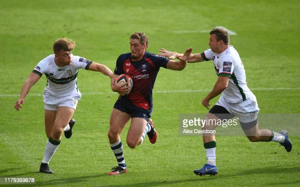 Tiff Eden of Bristol Bears attempts to get through Brendan Macken and Ollie Hassell-Collins of London Irish during the Premiership Rugby Cup Third...
