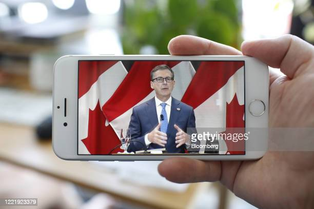 Tiff Macklem governor of the Bank of Canada speaks speaks during a video conference seen on a smartphone in Ottawa Ontario Canada on Monday June 22...