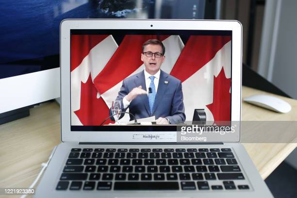 Tiff Macklem governor of the Bank of Canada speaks speaks during a video conference seen on a laptop computer in Ottawa Ontario Canada on Monday June...