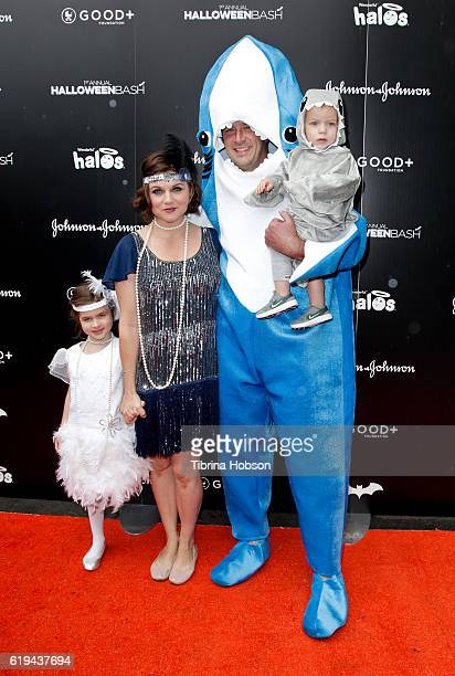 Tiffani Thiessen and Brady Smith and family attend the GOOD Foundation's 1st Halloween Bash at Sunset Gower Studios on October 30 2016 in Hollywood...