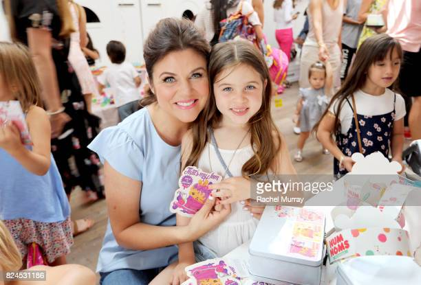 Tiffani Thiessen and daughter Harper decorate lunch boxes during the Num Noms event hosted by Tiffani Thiessen at Au Fudge Los Angeles on July 30...