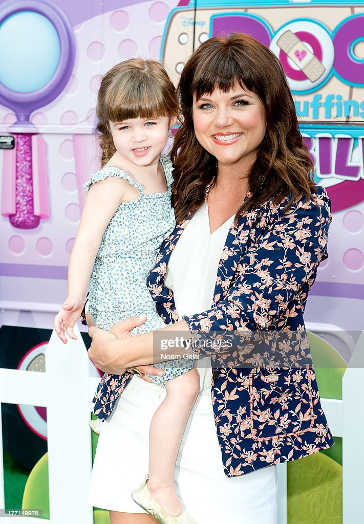 Tiffani Thiessen and daughter Harper Smith attend the Doc Mobile Tour at the Disney Store on August 21, 2013 in New York City.