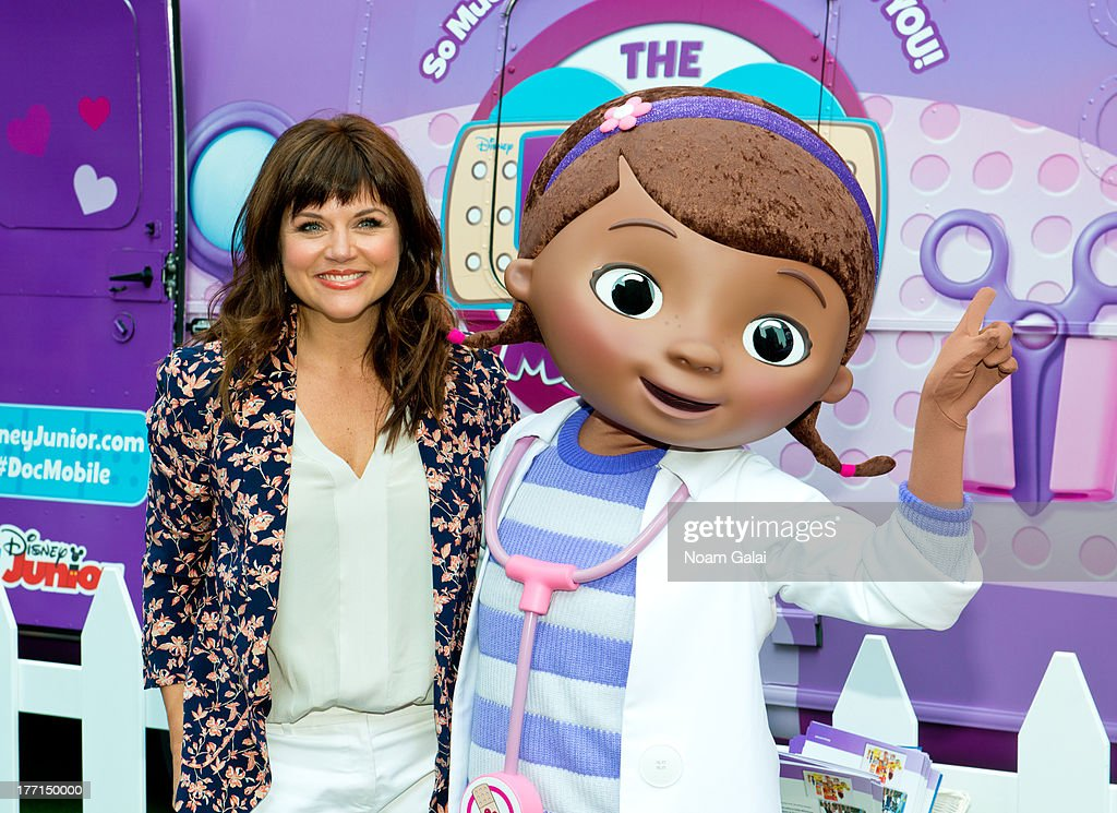 Tiffani Thiessen and Doc McStuffins attend the Doc Mobile Tour at the Disney Store on August 21, 2013 in New York City.
