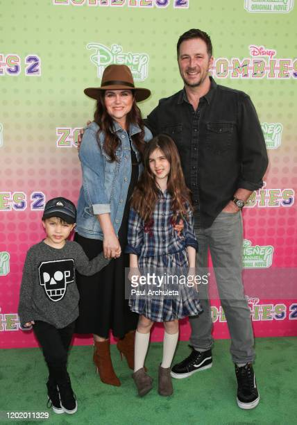 Tiffani Thiessen and her Husband Brady Smith with their kids attend the screening of the Disney Channel original movie ZOMBIES 2 at Walt Disney...