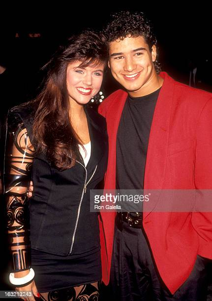 """Tiffani Thiessen and Mario Lopez attend the premiere of """"Bill & Ted's Bogus Journey"""" on July 11, 1991 at Mann Chinese Theater in Hollywood,..."""