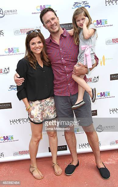 Tiffani Thiessen Brady Smith and Harper Smith attend the 6th Annual Family Affair hosted by CMEE at Children's Museum of the East End on July 19 2014...