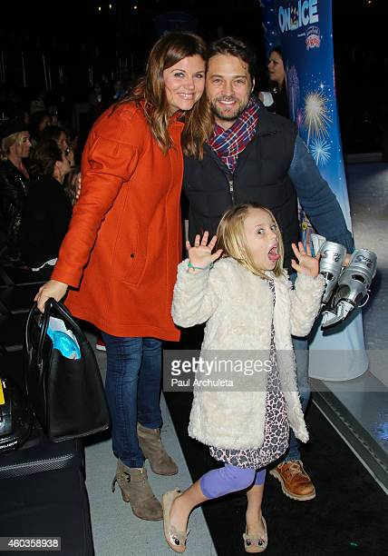 Tiffani Thiessen Jason Priestley and Ava Priestley attend Disney On Ice Let's Celebrate at Staples Center on December 11 2014 in Los Angeles...