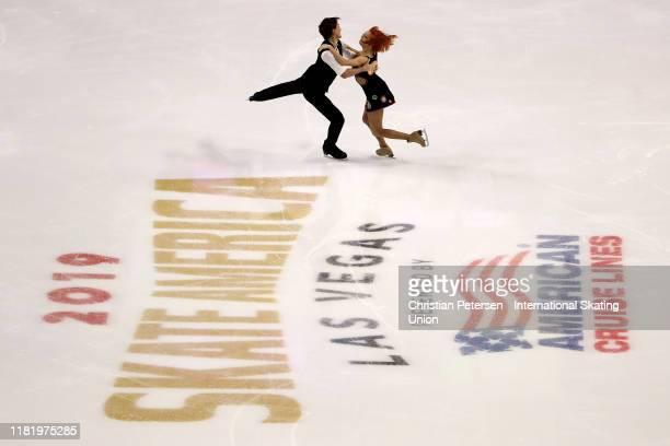 Tiffani Zagorski and Jonathan Guerreiro of Russia perform during ice dance rhythm dance in the ISU Grand Prix of Figure Skating Skate America at the...
