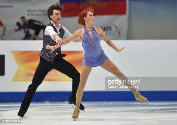Tiffani Zagorski and Jonathan Guerreiro of Russia perform in the pairs Ice Dance Rhythm Dance event of the ISU European Figure Skating Championships...