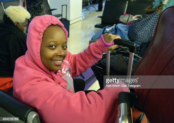 Tiffany Ammons of Detroit tries to make her way home from Dallas/Fort Worth International Airport after a trip to Antigua Guatemala Friday Dec 6 2013...