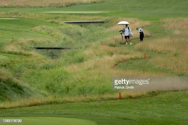 Tiffany Chan of Hong Kong plays her shot on the fourth hole during the second round of the LPGA Drive On Championship at Inverness Club on August 1,...
