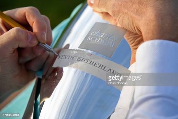 Tiffany Co Master Engraver Tim Murphy etches Kevin Sutherland's name on the Schwab Cup after the PGA TOUR Champions Charles Schwab Cup Championship...