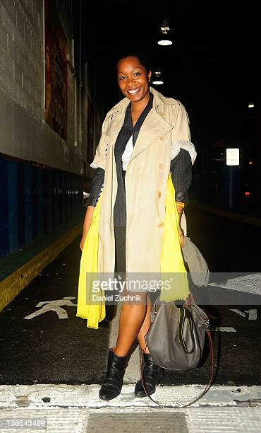 Tiffany Davis editor at Daily Candy is seen leaving the Rachel Comey show wearing J Crew scarf belt Tokyo 7 shoes Club Monaco jacket Zara skirt J...