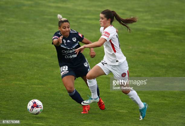 Tiffany Eliadis of the Victory and Rachel Lowe of the Wanderers compete for the ball during the round eight WLeague match between the Melbourne...