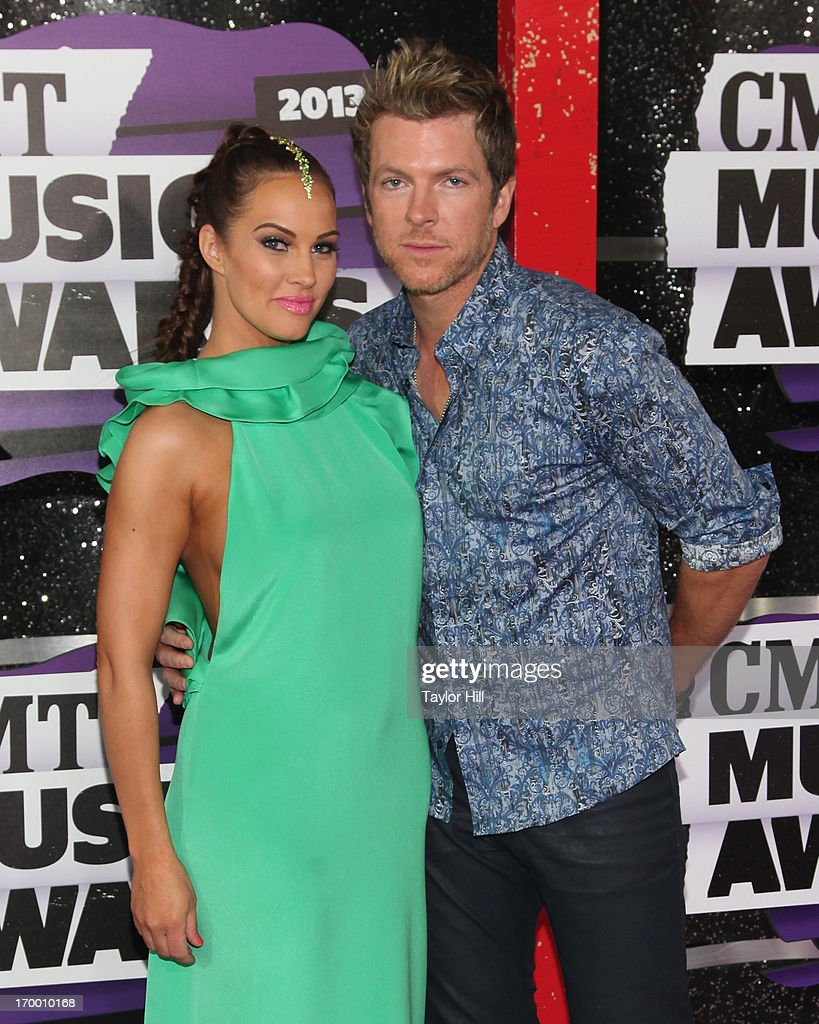 Tiffany Fallon and Joe Don Rooney of Rascal Flatts attend the 2013 CMT Music awards at the Bridgestone Arena on June 5, 2013 in Nashville, Tennessee.