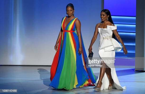 Tiffany Haddish and Angela Bassett walk onstage during the 70th Emmy Awards at Microsoft Theater on September 17 2018 in Los Angeles California