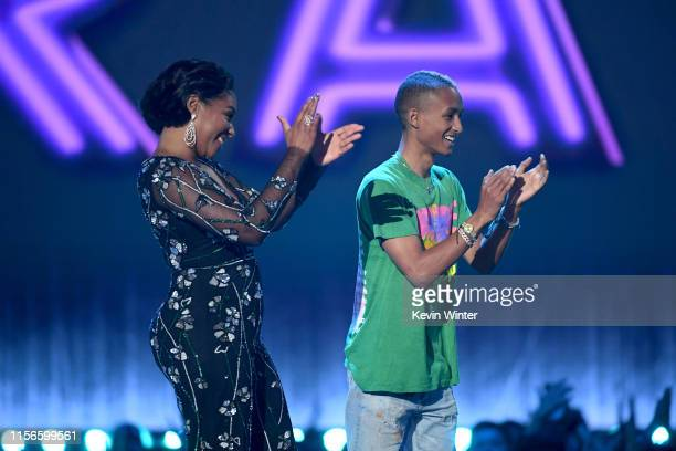 Tiffany Haddish and Jaden Smith speak onstage during the 2019 MTV Movie and TV Awards at Barker Hangar on June 15 2019 in Santa Monica California