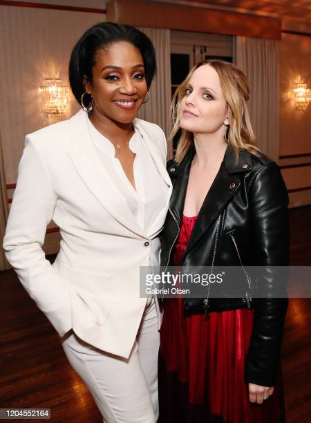 Tiffany Haddish and Mena Suvari attend Red Carpet Green Dress at the Private Residence of Jonas Tahlin CEO of Absolut Elyx on February 06 2020 in Los...
