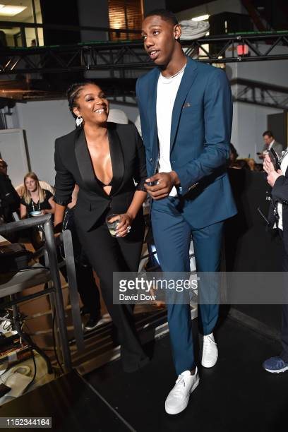 Tiffany Haddish and RJ Barrett of the New York Knicks walk to the stage during the 2019 NBA Awards Show on June 24 2019 at Barker Hangar in Santa...