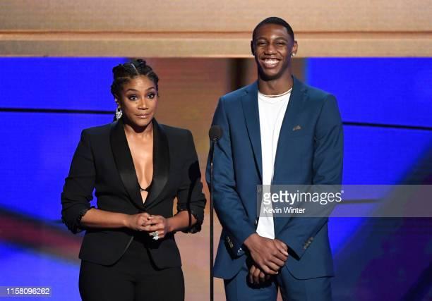 Tiffany Haddish and RJ Barrett speak onstage during the 2019 NBA Awards presented by Kia on TNT at Barker Hangar on June 24 2019 in Santa Monica...