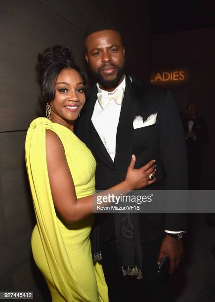 Tiffany Haddish and Winston Duke attend the 2018 Vanity Fair Oscar Party hosted by Radhika Jones at Wallis Annenberg Center for the Performing Arts...