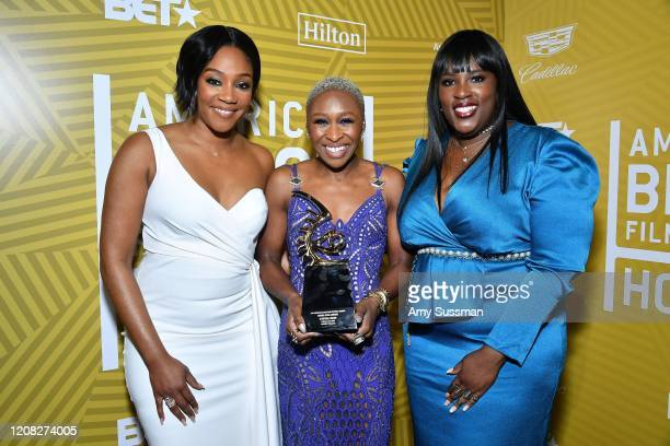 Tiffany Haddish Cynthia Erivo and Director Multicultural Diversity Relations of Hilton Andrea Richardson pose with the Rising Star Award backstage...