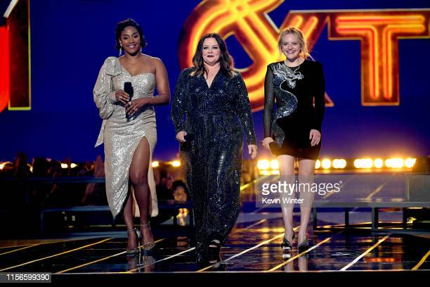 Tiffany Haddish Melissa McCarthy and Elisabeth Moss speak onstage during the 2019 MTV Movie and TV Awards at Barker Hangar on June 15 2019 in Santa...