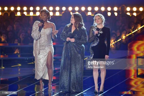 Tiffany Haddish Melissa McCarthy Elisabeth Moss present onstage during the 2019 MTV Movie and TV Awards at Barker Hangar on June 15 2019 in Santa...