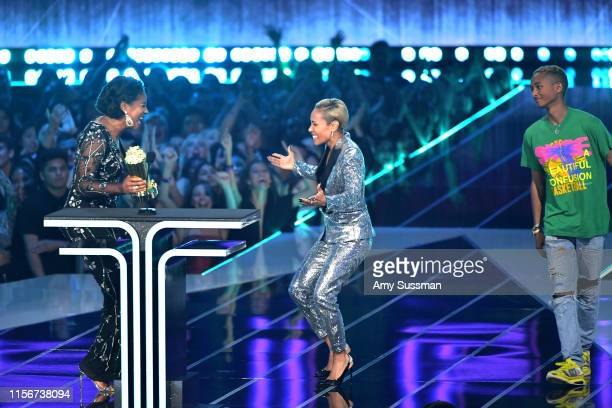 Tiffany Haddish presents Jada Pinkett Smith with the MTV Trailblazer Award onstage during the 2019 MTV Movie and TV Awards at Barker Hangar on June...