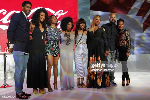 Tiffany Haddish Regina Hall Queen Latifah and Jada Pinkett Smith from the movie Girls Trip pose for a photo with the winners of a karaoke competition...