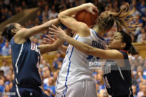 Tiffany Hayes and Bria Hartley of the Connecticut Huskies pressure Allison Vernerey of the Duke Blue Devils at Cameron Indoor Stadium on January 30...