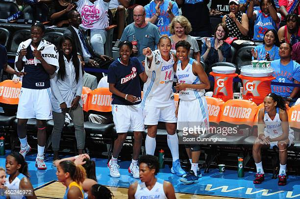 Tiffany Hayes Erika deSouza and Angel McCoughtry of the Atlanta Dream celebrate on the bench during the game against the Chicago Sky on June 7 2014...
