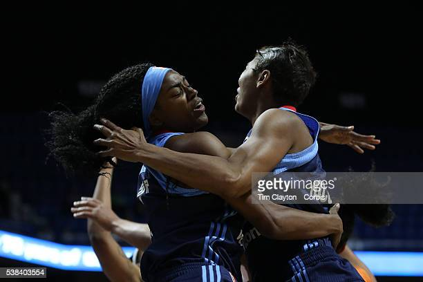 Tiffany Hayes of the Atlanta Dream and team mate Angel McCoughtry of the Atlanta Dream collide with each other while rebounding during the Atlanta...