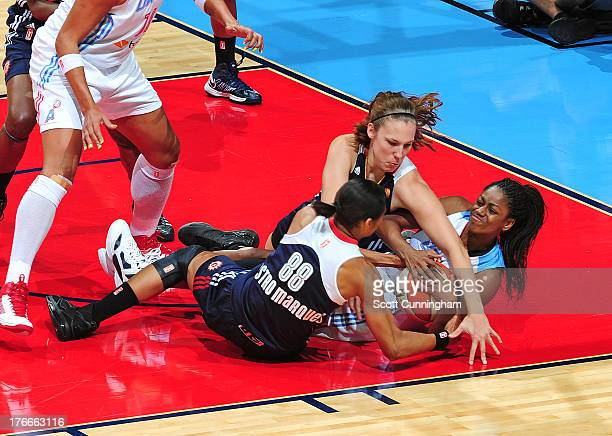 Tiffany Hayes of the Atlanta Dream battles for a loose ball against Iziane Castro Marques and Kayla Pedersen of the Connecticut Sun at Philips Arena...