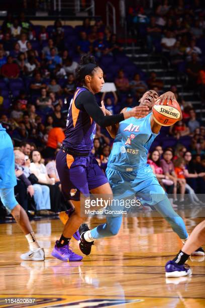 Tiffany Hayes of the Atlanta Dream battles for possession of the ball during the game against Briann January of the Phoenix Mercury on July 7 2019 at...