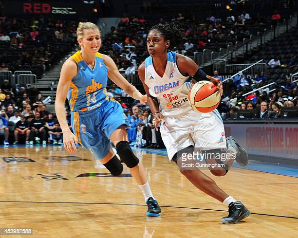 Tiffany Hayes of the Atlanta Dream drives against Allie Quigley of the Chicago Sky in Game One of the Eastern Conference Semifinals during the 2014...