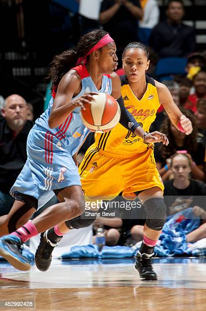 Tiffany Hayes of the Atlanta Dream drives against Angel Goodrich of the Tulsa Shock during the WNBA game on July 31 2014 at the BOK Center in Tulsa...