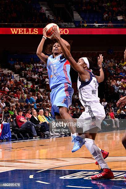 Tiffany Hayes of the Atlanta Dream shoots against Allison Hightower of the Connecticut Sun on June 01 2014 at the Mohegan Sun Arena in Uncasville...