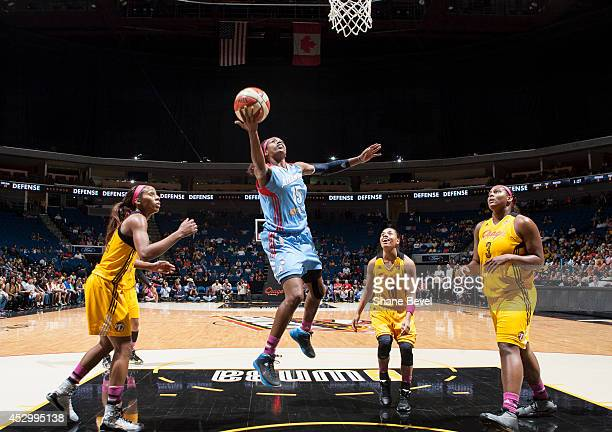 Tiffany Hayes of the Atlanta Dream shoots against Glory Johnson Angel Goodrich and Courtney Paris of the Tulsa Shock during the WNBA game on July 31...