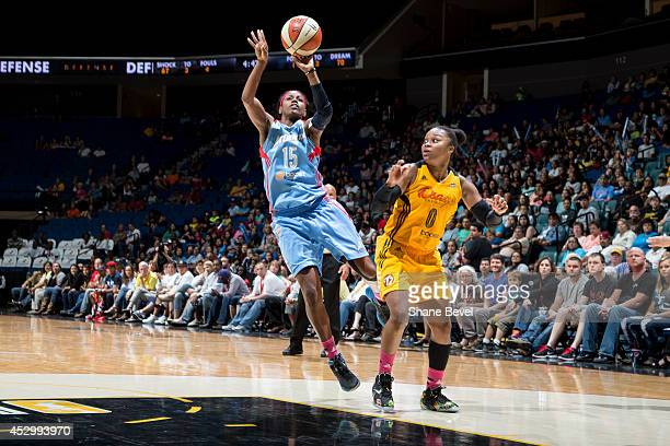 Tiffany Hayes of the Atlanta Dream shoots against Odyssey Sims of the Tulsa Shock during the WNBA game on July 31 2014 at the BOK Center in Tulsa...