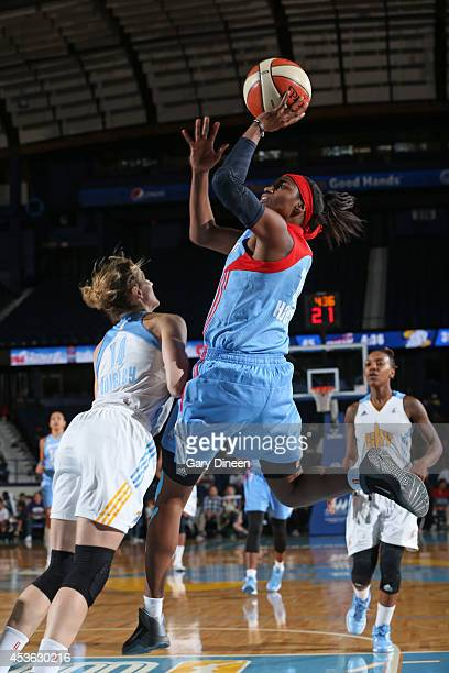 Tiffany Hayes of the Atlanta Dream shoots the ball against Allie Quigley of the Chicago Sky on August 10 2014 at the Allstate Arena in Rosemont...