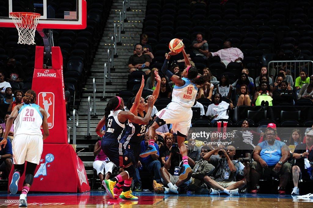 Tiffany Hayes #15 of the Atlanta Dream shoots the ball against Alyssa Thomas #25 of the Connecticut Sun on July 29, 2014 at Philips Arena in Atlanta, Georgia.