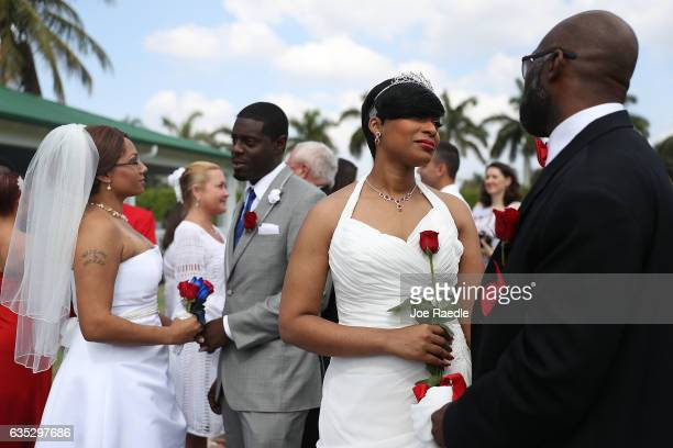 BEACH FL FEBRUARY Tiffany Hinds and Rashaun Hinds along with Tierra Hunter and Jeffery Hunter participate in a group Valentine's day wedding ceremony...