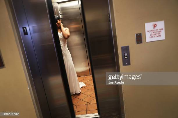 Tiffany Hinds arrives in an elevator for the group Valentine's day wedding ceremony at the National Croquet Center on February 14 2017 in West Palm...