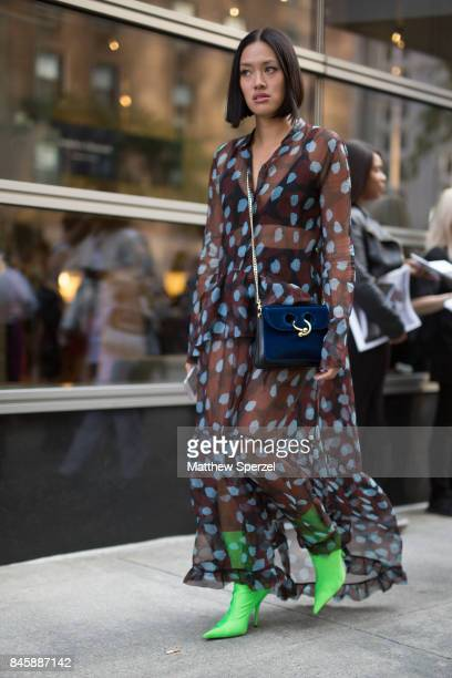 Tiffany Hsu is seen attending Oscar de la Renta during New York Fashion Week wearing a sheer dress with green shoes on September 11 2017 in New York...