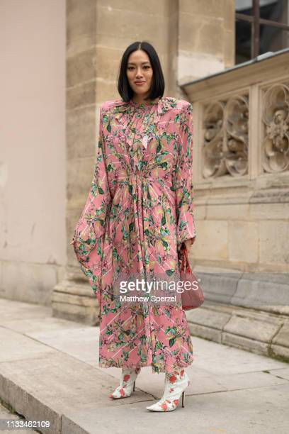 Tiffany Hsu is seen on the street attending THOM BROWNE during Paris Fashion Week AW19 wearing THOM BROWNE pink floral dress with red bag on March 03...