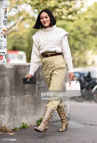 Tiffany Hsu is seen wearing a cream sweater and beige pants with snakeskin boots outside the Haider Ackermann show during Paris Fashion Week SS20 on...