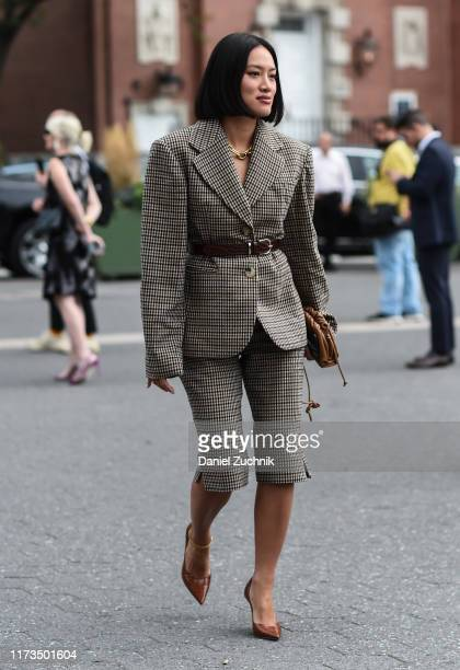 Tiffany Hsu is seen wearing a plaid suit brown belt and brown shoes outside the Carolina Herrera show during New York Fashion Week S/S20 on September...